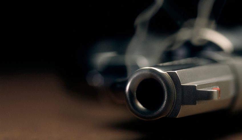 Smoking gun lying on the floor, revolver