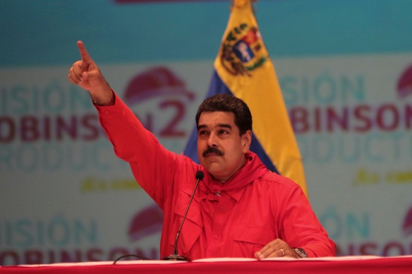 Venezuela's President Nicolas Maduro gestures during an event with supporters in Caracas
